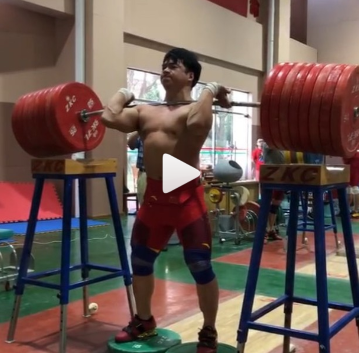 Chinese Olympic Weightlifters Lu Xiaojun and Tian Tao oerform rack holds and jerk dips with weight far heavier than their max effort clean and jerk and front squat.