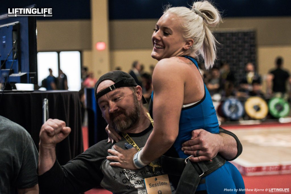 Travis Mash celebrates Hunter Elam's 121 kg clean and jerk
