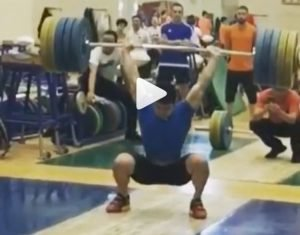 Chinese weightlifter and Olympic Champion Shi ZhiYong clean and jerks 206 kg in training.