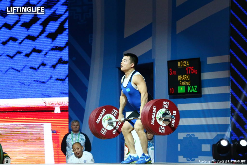 Kazakhstan weightlifter KHARKI Farkhad clean and jerking 175 kg at the 2018 Weightliftng World Championships