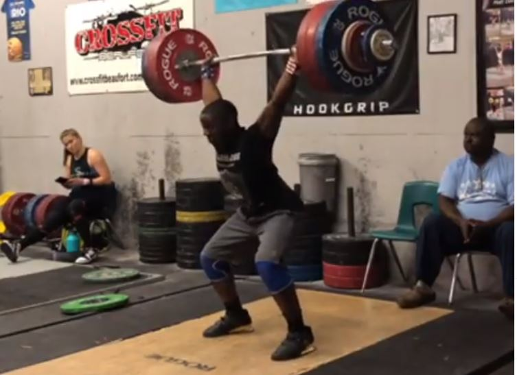 Youth WOrld Record holder CJ Cummings for a clean plus two jerks