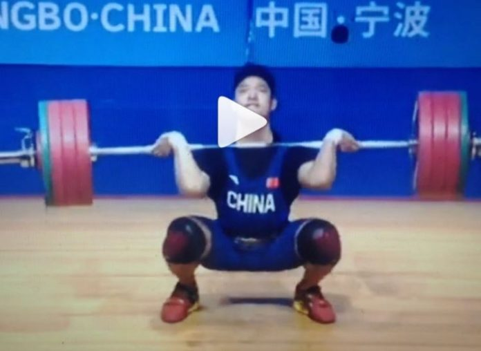 Chinese weightlifter Li Dayin attempts a 200 kg clean and jerk
