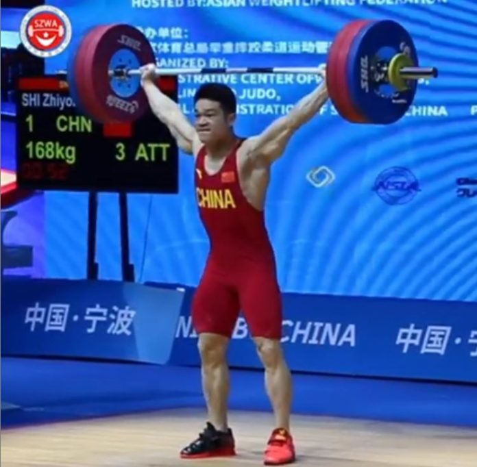 Chinese weightlifter Shi Zhiyong snatching a world record of 168 kg