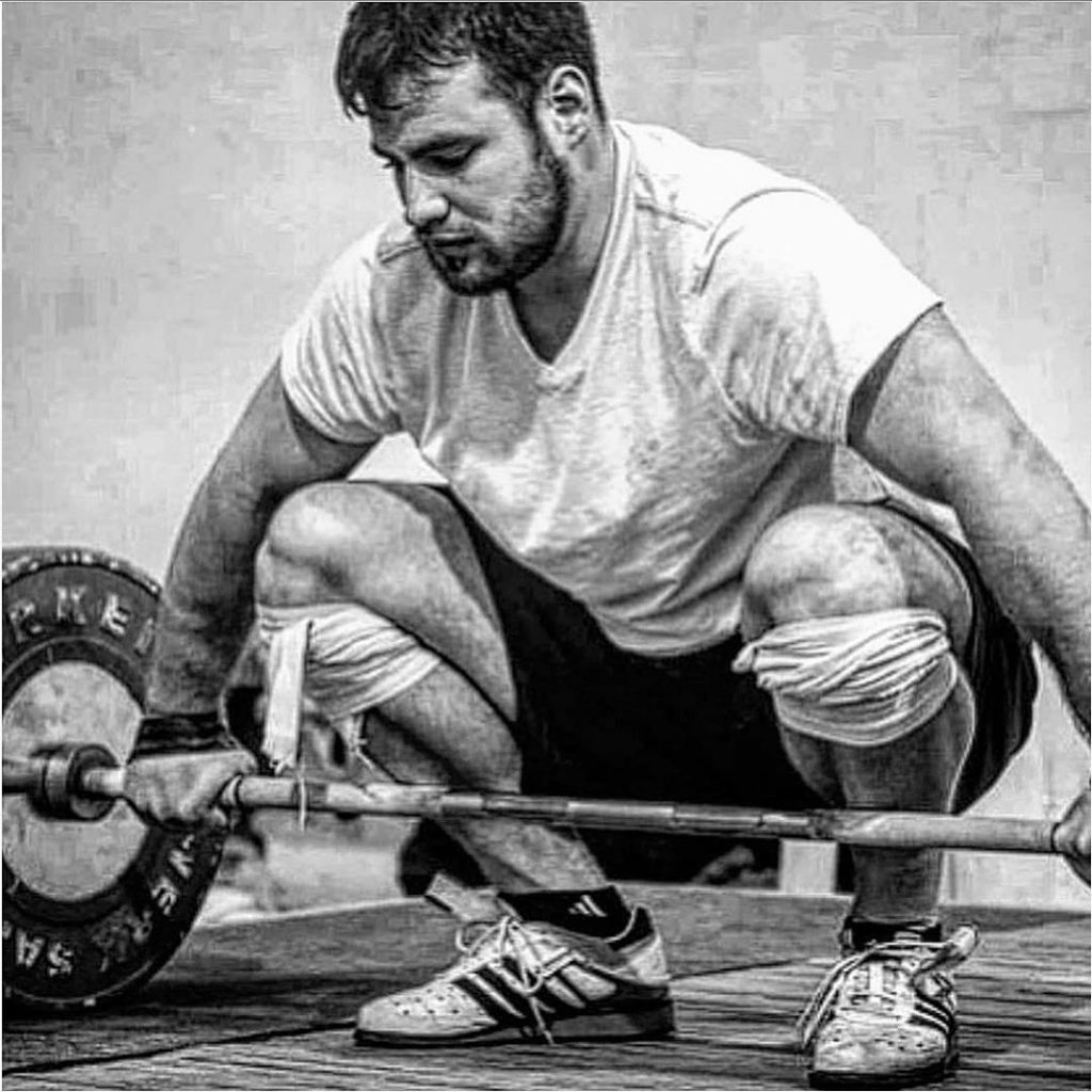 Jon North explaining his technique on how to snatch on the weightlifting house podcast