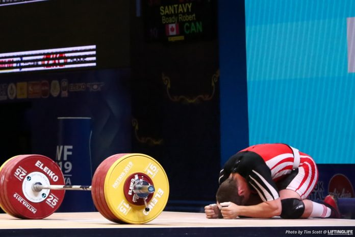 Boady Satavy celebrates after his 210kg PR clean and jerk at the 2019 World Weightlifting Championships